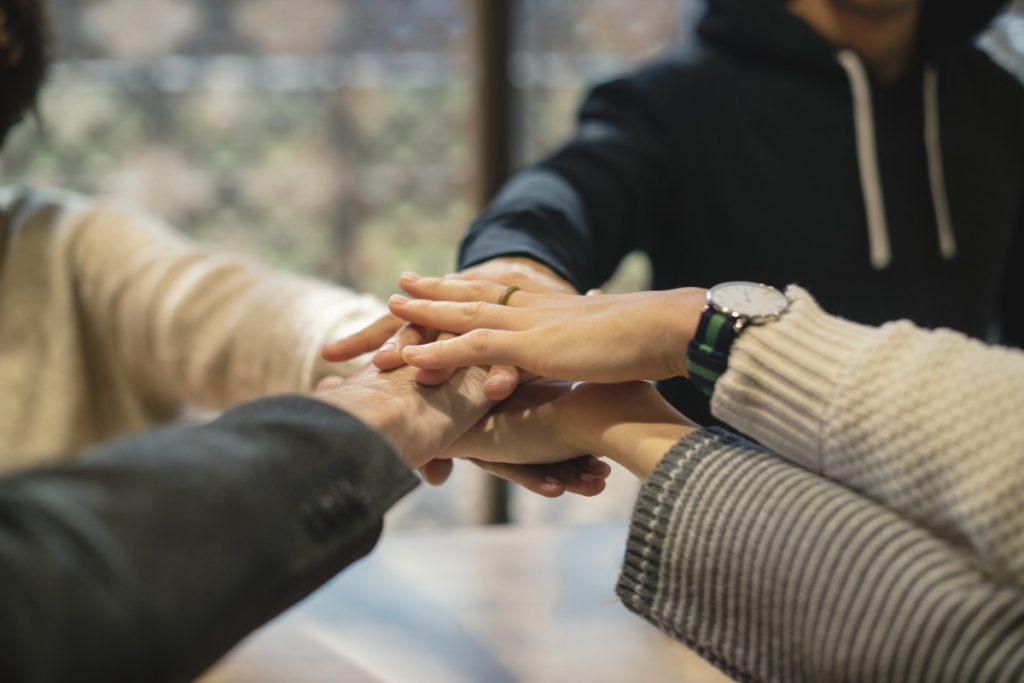 Staff holding hands